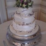 beaded garland and fresh flowers wedding cake