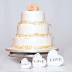 gold beaded garland wedding cake